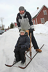 Family on Kicksled in Kolkja Kelk, Tartu County, Estonia