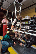 Dayton, Ohio - December 16, 1982. Paraplegic Nan Davis, 22 years old, learns to walk at the labrotaory of Dr Donald Petrofsky in Wright State University. This program was developed to enable computers to help individuals suffering from muscle malfunction, or require rehabilitation, to regain muscle control.
