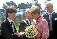 Princess Anne on a May 1985 visit to N Ireland is pictured receiving a &pound;2000 cheque for the Save the Children organization from pupil, Philip Shaw, at the official opening of an extension to Belfast Royal Academy's Preparatory Department at its Ben Madigan campus. Princess Anne is president of Save the Children. Also in the photo is Secretary of State, Douglas Hurd. 19850501m<br />