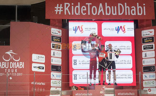 The final podium overall race winner (centre) Rui Costa (POR) UAE Abu Dhabi team, 2nd place Ilnur Zakarin (RUS) Team Katusha Alpecin and 3rd Tom Dumoulin (NED) Team Sunweb at the end of Stage 4 Yas Island Stage of the 2017 Abu Dhabi Tour, 143km with 26 laps of 5.5km of the Yas Marina Circuit, Abu Dhabi. 26th February 2017.<br /> Picture: ANSA/Claudio Peri | Newsfile<br /> <br /> <br /> All photos usage must carry mandatory copyright credit (&copy; Newsfile | ANSA)