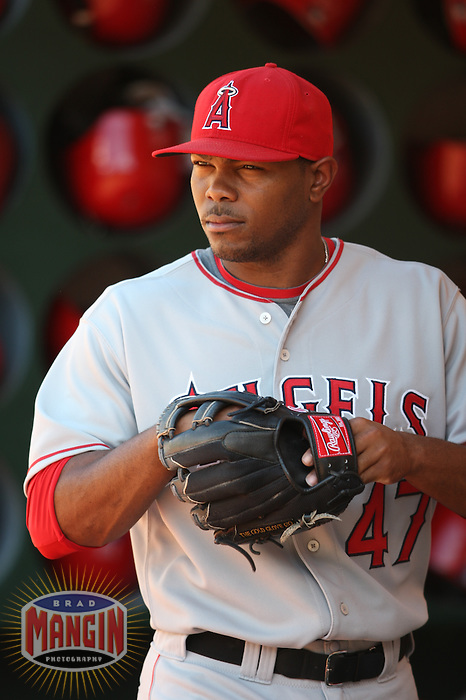 OAKLAND, CA - JUNE 7:  Howie Kendrick of the Los Angeles Angels of Anaheim gets ready in the dugout before the game against the Oakland Athletics at the McAfee Coliseum in Oakland, California on June 7, 2008.  The Angels defeated the Athletics 5-3.  Photo by Brad Mangin
