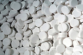 A large assortment of white tablets. Royalty Free