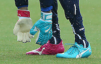 The odd coloured Puma goalkeeping gloves and football boots of Italy goalkeeper Gianluigi Buffon during training ahead of tomorrow's Group D fixture vs Uruguay