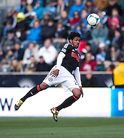 Sheanon Williams (25) of the Philadelphia Union heads the ball during the game at PPL Park in Chester, PA.  Kansas City defeated Philadelphia, 3-1.