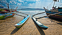 Colorful outriggers on the sand, Sri Lanka. (Photo by Matt Considine - Images of Asia Collection)