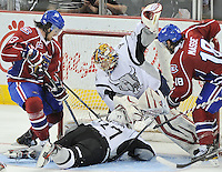 San Antonio Rampage goaltender Jacob Markstrom, center, guards the net against Hamilton Bulldogs' Zack FitzGerald, left, and Dany Masse, right, as San Antonio's Sean Sulivan slides into the net during the second period of an AHL hockey game, Wednesday, March 28, 2012, in San Antonio. (Darren Abate/pressphotointl.com)