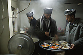 BIARA, IRAQ: Omar Ahmad (19) and Ali Osman (21) prepare dinner for the rest of the students...The Biara Madrassa--a religious school--is located high up in the mountainous Kurdish Hawraman region that makes up the Iran/Iraq border. Before 2003 the region was home to a fundamentalist Islamic group called Ansar al-Islam who used the school as a base. The Unites States military attacked the area and the madrassa numerous times during the 2003 invasion, finally pushing Ansar al-Islam out...Today the madrassa is home to 48 male students from all across Kurdish Iraq. The students leave their families and immerse themselves in their studies and the daily life of Koranic students...Photo by Besaran Tofiq