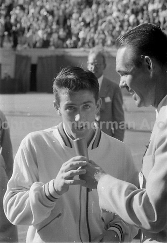 Australian tennis player Ken Rosewall speaks with Jack Kramer after winning 1956 U.S. Men's National Championship against fellow Australian Lew Hoad. West Side Tennis Club, Forest Hills, New York. Photograph by John G. Zimmerman.