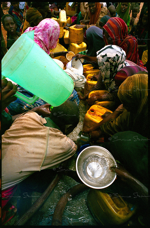 Goobato, Somalia, March 2006..Chaotic water distribution as a tanker truck operated by ACF reaches the village..