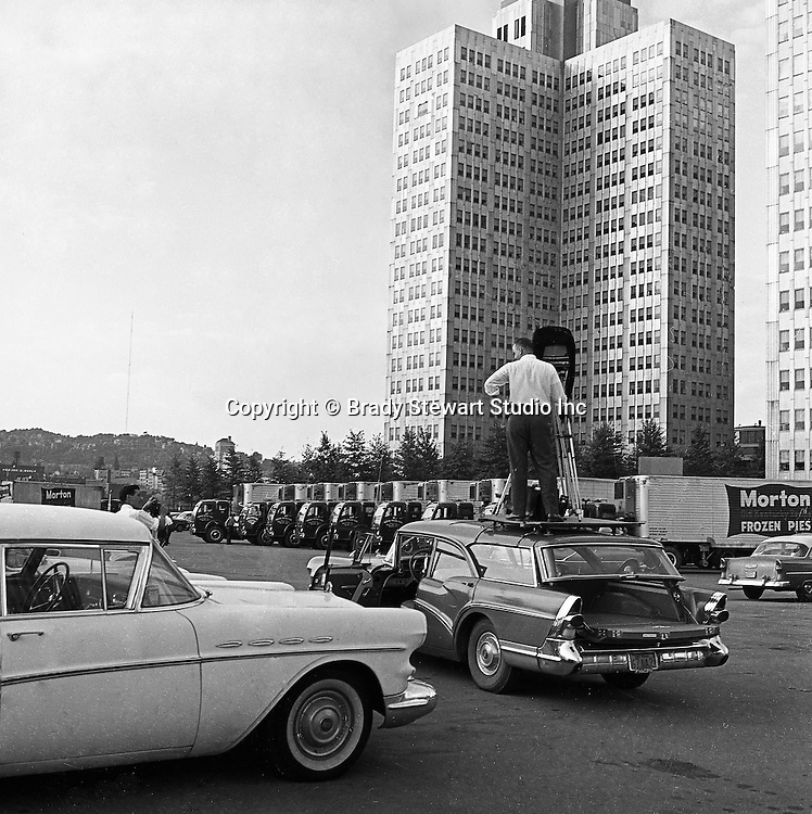 Pittsburgh PA:  Brady Stewart Studio on location for Morton Frozen Pies at Gateway Center in downtown Pittsburgh - 1957.  Assignment was for Ketchum McLeod and Grove Advertising. Brady Stewart Jr. and Ross Catanza handled the unique assignment.  View of Brady Stewart Jr. on top of the family's new 1957 Buick station wagon to get the right height for the shot.