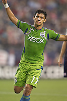 Seattle Sounders forward Fredy Montero (17) celebrates his goal. In a Major League Soccer (MLS) match, the Seattle Sounders FC defeated the New England Revolution, 2-1, at Gillette Stadium on October 1, 2011.