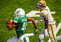 Sports Action Photography - Charlotte 49er NCAA college football game between the University of North Carolina at Charlotte and Johnson C. Smith University  in Charlotte, N.C., Saturday, September 6, 2014.  Charlotte went on to beat JCSU 56-0 at Jerry Richardson Stadium in front 15,000 fans.<br /> <br /> Photo by: PatrickSchneiderPhoto.com