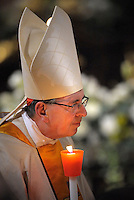 cardinal  Kurt Koch;Pope Francis, holds a candle during the Easter vigil mass in Saint Peter's Basilica, in the Vatican.,30 March 2013