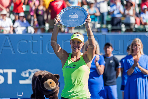 09.08.2015. Stanford, California, USA.  Angelique Kerber (GER) shows off her hardware after defeating Karolina Pliskova (CZE) in the finals of the Bank of the West Classic at Stanford University's Taube Family Tennis Center in Stanford, Calif.