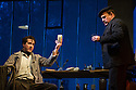 London, UK. 27.10.2014. Jonathan Miller's production, for English National Opera, of LA BOHEME, by Giacomo Puccini, opens at the London Coliseum. Rising star soprano, Angel Blue, makes her role debut as Mimi. Picture shows: George von Bergen (Marcello), Andrew Shore (Benoit). Photograph © Jane Hobson.