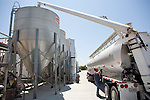 Robert Taylor loads chicken feed at J.S. West's egg production facility in Atwater, California,  August 11, 2010. California's Proposition 2, passed in 2008, requires that egg-laying hens in California be able to fully extend their limbs, lie down and turn in a circle within their enclosures. .CREDIT: Max Whittaker for The Wall Street Journal.EGGS