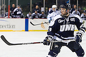 Kevin McCarey (UNH - 23) - The University of Maine Black Bears defeated the University of New Hampshire Wildcats 5-4 in overtime on Saturday, January 7, 2012, at Fenway Park in Boston, Massachusetts.