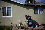 Francisco Gonzalez digs up his septic tank after noticing his lawn sinking above it in the Parklawn neighborhood in Modesto, Calif., March 20, 2012.