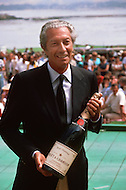 August 26th, 1984. Mr. Chandon, CEO of Moett and Chandon Champagne, with a bottle and talking to relatives.