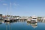 Grand Bahama Island, The Bahamas; yachts and sail boats reflect in the waters of Port Lucaya Marina