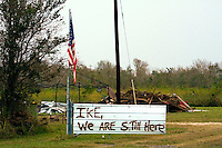 At a home on High Island, east of Galveston Bay, people are defiant after Hurricane Ike blew through the area in 2008.