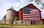 A collection of Barns that still can be seen while traveling the countryside in  the beautiful State of Wisconsin.<br /> Oneida County- Barn with American flag-Oneida County off River Road near fairgrounds.