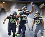 Seattle Seahawk's Sidney Rice,(18), Max Under, (60), and Mike Morgan, (57), head out onto the field before their game against the Dallas Cowboys at CenturyLink Field in Seattle, Washington on September 16, 2012.  The Seahawks beat the Cowboys 27-7. 2012. Jim Bryant Photo. ALL RIGHTS RESERVED.
