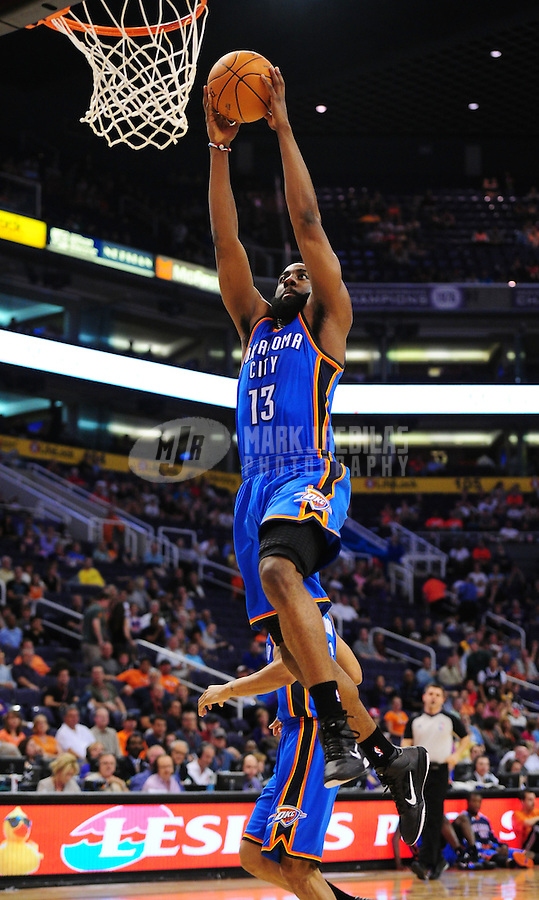 Mar. 30, 2011; Phoenix, AZ, USA; Oklahoma City Thunder guard (13) James Harden against the Phoenix Suns at the US Airways Center. Mandatory Credit: Mark J. Rebilas-