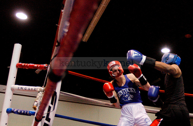 Nate Angel ducks back from a punch thrown by Deshawn Cook at The Main Event on Friday Nov. 6, 2010. Photo by Britney McIntosh | Staff