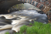 A stone bridge crosses the Eau Claire River at the Dells of the Eau Claire River County Park in Marathon County Wisconsin.