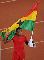 John Pantsil of Ghana celebrates while holding the Ghana national flag. Ghana defeated the USA 2-1 in overtime in the 2010 FIFA World Cup at Royal Bafokeng Stadium in Rustenburg, South Africa on June 26, 2010.