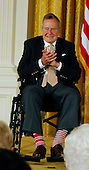 Former United States President George H.W. Bush and U.S. President Barack Obama (not pictured) at a ceremony in the East Room of the White House to present the 5,000th &quot;Daily Point of Life&quot; on July 15, 2013.  Photograph by Dennis Brack<br /> Credit: Dennis Brack / Pool via CNP