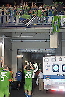 Seattle Sounders defender Zach Scott (20) acknowledges Seattle Sounders traveling fans. In a Major League Soccer (MLS) match, the Seattle Sounders FC defeated the New England Revolution, 2-1, at Gillette Stadium on October 1, 2011.
