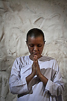 """MAE CHEE TIAP practices meditation inside a cave of the Sathira Dhammasathan meditacion centre. Para-monastic institutions in Thailand, like the Sathira Dhammasathan meditation centre, not allow the lay nuns (""""mae chees"""") to held a temple, but not deny them to practice the spiritual life. Increasingly """"mae chii"""" can be found in these independent ?nunneries? or """"samnak chii"""" where they undertake domestic duties, grow crops, practice meditation, undertake studies in the dharma and, increasingly, provide teaching in the dharma and meditation to lay Buddhists."""