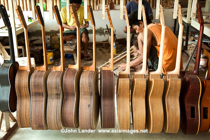 "Guitar Makers at Alegre, Mactan Cebu - Though pre-colonial Visayans had a variety of string instruments which used a coconut shell or gourd as resonator - the guitar is a Spanish introduction. Guitars have been made in Cebu since the Spanish period mainly as a areplacement for organs for church music until they were later imported. Yet, guitars  developed as a local industry only in the present century, receiving a boost from the government's promotion of cottage industries in the immediate postwar period. In Mactan, the craft of guitar making passes from generation to generation and the industry involves many families, the most prominent of whom is the Alegre and Malingin families whose names have become well-known ""brand names"" of Mactan or Cebu guitars."