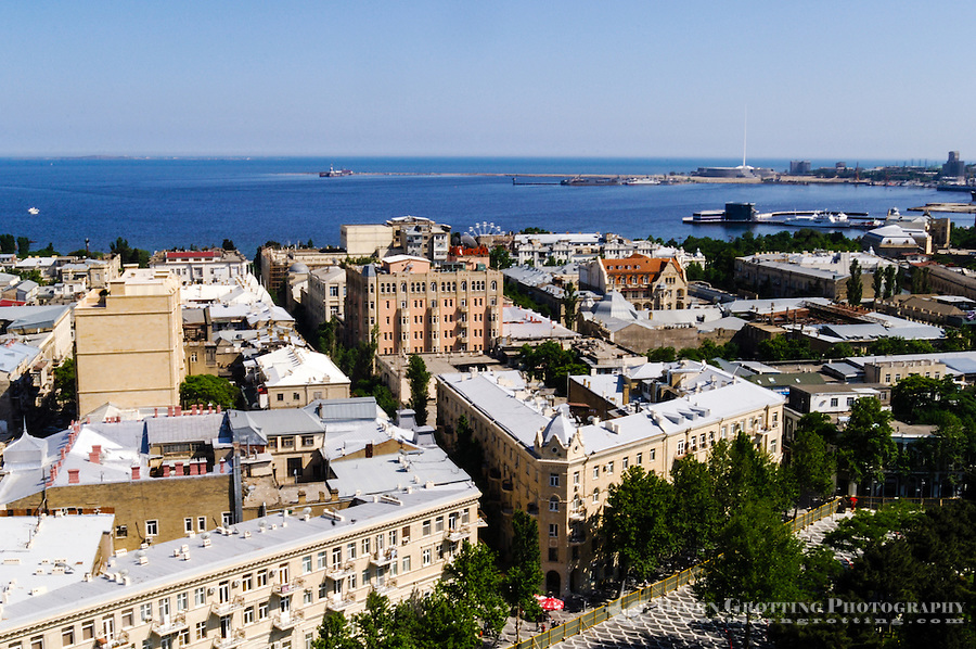 Azerbaijan, Baku. Baku city view with tha harbour and the Caspian Sea in the background.