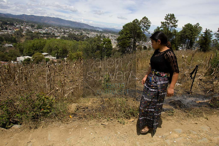 Maria, 16, walks in her friend Alma's neighborhood in Chimaltenango, Guatemala on Thursday, March 8, 2007. Maria works at Legumex, a vegetable and fruit company that exports to the United States. She injured her wrist on the job and couldn't work today.