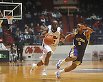 "Mississippi guard Chris Warren (12) is defended by Alcorn State's Alex Savannah (3) at the C.M. ""Tad"" Smith Coliseum in Oxford, Miss. on Thursday, December 29, 2010. (AP Photo/Oxford Eagle, Bruce Newman)"