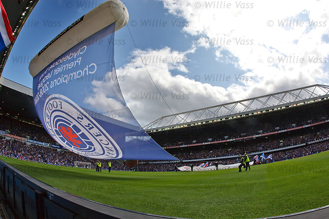 Rangers groundstaff struggle to control a giant banner before the SPL season kick-off at Ibrox