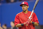4 April 2015: Cincinnati Reds outfielder Billy Hamilton awaits his turn in the batting cage prior to an exhibition game against the Toronto Blue Jays at Olympic Stadium in Montreal, Quebec, Canada. The Blue Jays defeated the Reds 9-1 in the second of two MLB weekend exhibition games. The series marked the first time since 2004 that the Reds played at Olympic Stadium, during the last season of the Montreal Expos. Mandatory Credit: Ed Wolfstein Photo *** RAW (NEF) Image File Available ***