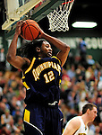 13 December 2009: Quinnipiac University Bobcats' forward Justin Rutty, a Junior from Newburgh, NY, in action against the University of Vermont Catamounts at Patrick Gymnasium in Burlington, Vermont. The Catamounts defeated the visiting Bobcats 80-77 to mark the Cats' season home opener with a win. Mandatory Credit: Ed Wolfstein Photo