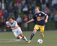 New York Red Bulls midfielder Dax McCarty (11) on the attack.  2013 Lamar Hunt U.S Open Cup fourth round, New England Revolution (white) defeated New York Red Bulls (blue/yellow), 4-2, at Harvard University's Soldiers Field Soccer Stadium on June 12, 2013.
