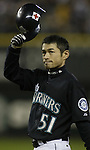 Seattle Mariners' Ichiro Suzuki tips his helmet to the crowd after he singled to right field in the second inning  against the Oakland Athletics in Seattle, Washington on Friday, 30 September, 2005. Ichiro, and collected his 200th hit to become just the sixth player in MLB history to collect 200 hits in five straight seasons. Jim Bryant Photo. ©2010. ALL RIGHTS RESERVED.