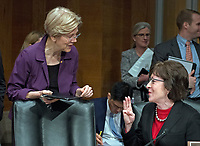 United States Senators Elizabeth Warren (Democrat of Massachusetts), left, and Susan Collins (Republican of Maine), right, meet before the hearing for R. Alexander Acosta, Dean of Florida International University College of Law and US President Donald J. Trump's nominee for US Secretary of Labor confirmation hearing before the US Senate Committee on Health, Education, Labor &amp; Pensions on Capitol Hill in Washington, DC on Wednesday, March 22, 2017.<br /> Credit: Ron Sachs / CNP /MediaPunch