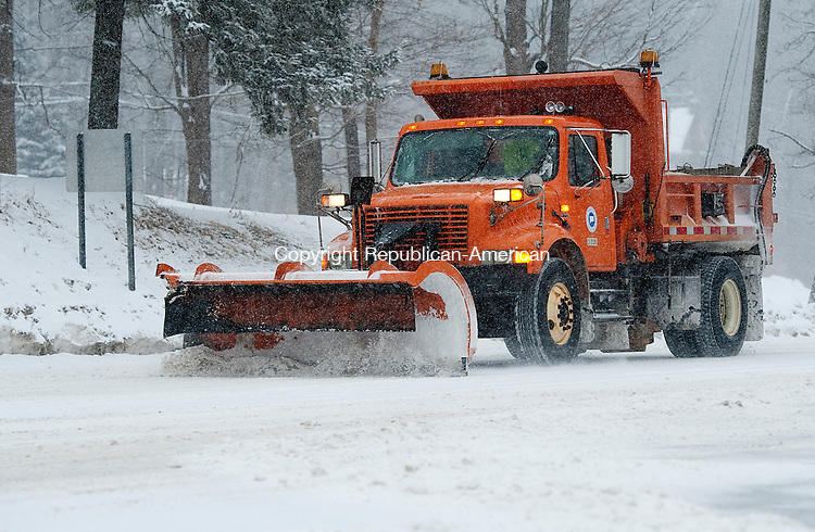 WINSTED, CT-021314JS02- A D.O.T. plow clears a portion of Route 44 in Winsted on Thursday as the snow begins to fall from the latest snowstorm. All the state plows as well as private contractors will be on the roads to clear the snow as it falls.  <br /> Jim Shannon Republican-American