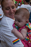 Lesbian mother holding  toddler son.<br />