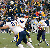 November 28, 2008. Pitt defensive lineman Jabaal Sheard (97) jumps high in the air to try to locate WVU quarterback Pat White (with ball). The Pitt Panthers defeated the West Virginia Mountaineers 19-15 on November 28, 2008 at Heinz Field, Pittsburgh, Pennsylvania.