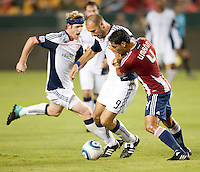 Revolution forward Ilija Stolica (9) shields Chivas defender Michael Umana (4) during the first half of the game between Chivas USA and the New England Revolution at the Home Depot Center in Carson, CA, on September 10, 2010. Chivas USA 2, New England Revolution 0.
