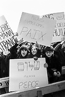 01 Mar 1970 --- Boys and girls demanding peace in an anti French demonstration in New York against the sale of 100 Mirage jets to Libya from France. After the election of French President George Pompidou foreign policies were changed and 100 Mirage fighter jets were sold to Colonel Gadaffi's new regime in Libya. --- Image by © JP Laffont