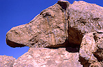 Buzzard Rock at Hueco Tanks State Park in West Texas, 30 miles north of El Paso, June 1998.  Hueco is a Spanish word meaning hollows and refers to the many water-holding depressions in the boulders and rock faces throughout the region.  Hueco Tanks is also widely regarded as one of the best areas in the world for bouldering (difficult climbing, low enough to attempt without ropes for protection), unique for its rock type, the concentration and quality of the climbing.